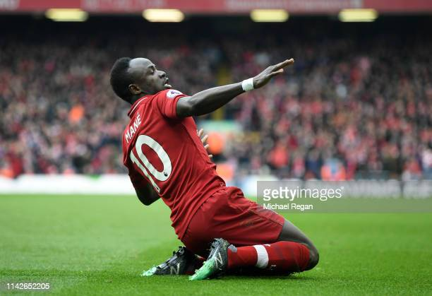 Sadio Mane of Liverpool celebrates after scoring his team's first goal during the Premier League match between Liverpool FC and Chelsea FC at Anfield...