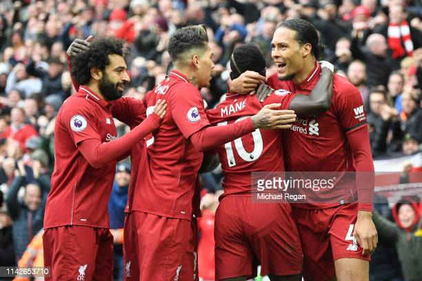 Sadio Mane of Liverpool celebrates after scoring his team's first goal with Virgil van Dijk Roberto Firmino and Mohamed Salah during the Premier...
