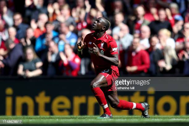 Sadio Mane of Liverpool celebrates after scoring his team's first goal during the Premier League match between Liverpool FC and Wolverhampton...