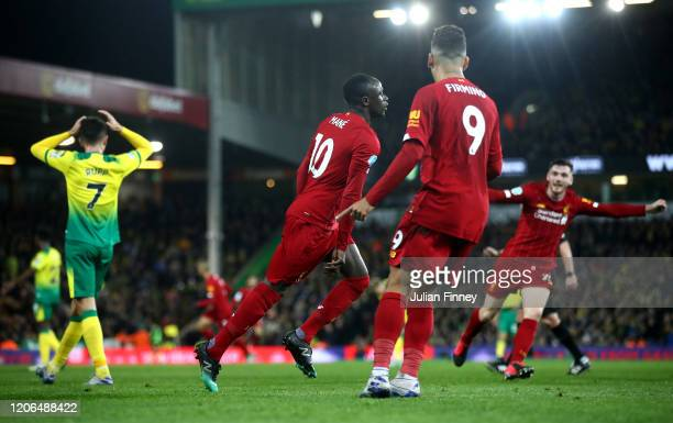 Sadio Mane of Liverpool celebrates after scoring his team's first goal during the Premier League match between Norwich City and Liverpool FC at...