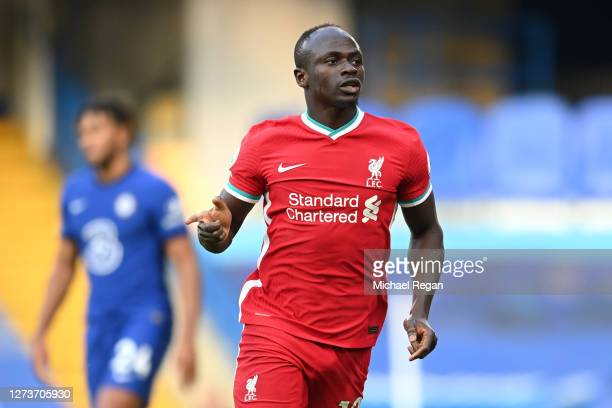 Sadio Mane of Liverpool celebrates after scoring his team's first goal during the Premier League match between Chelsea and Liverpool at Stamford...