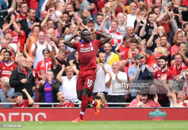Sadio Mane of Liverpool celebrates after scoring his team's second goal during the Premier League match between Liverpool FC and West Ham United at...