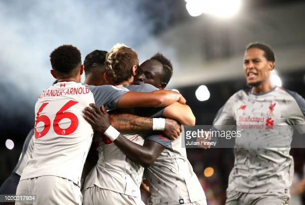 Sadio Mane of Liverpool celebrates after scoring his team's second goal with team mates during the Premier League match between Crystal Palace and...