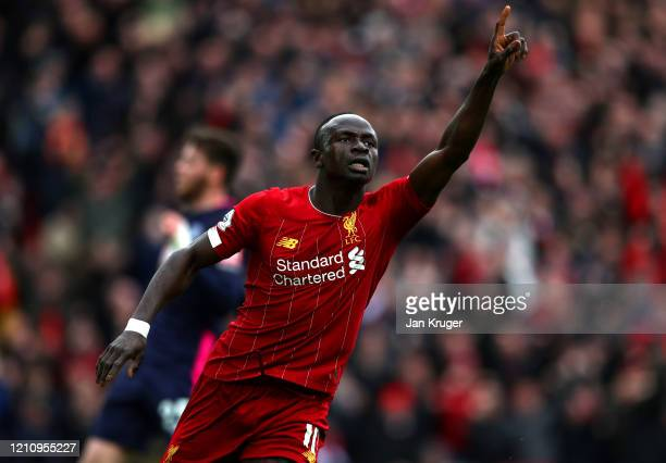 Sadio Mane of Liverpool celebrates after scoring his team's second goal during the Premier League match between Liverpool FC and AFC Bournemouth at...