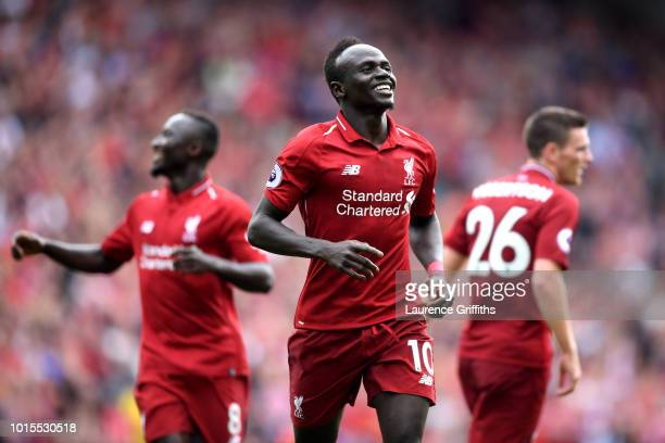 Sadio Mane of Liverpool celebrates after scoring his team's third goal during the Premier League match between Liverpool FC and West Ham United at...