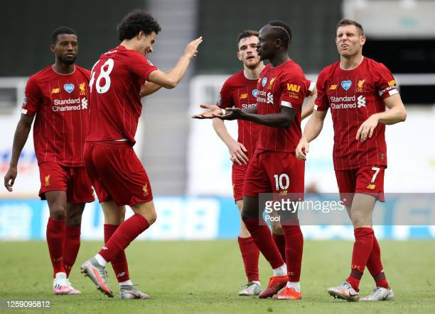 Sadio Mane of Liverpool celebrates after scoring his team's third goal with James Milner and Curtis Jones during the Premier League match between...