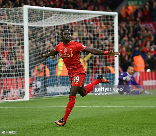 Sadio Mane of Liverpool celebrates after scoring the opening during the Premier League match between Liverpool and Watford at Anfield on November 6...