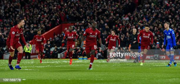 Sadio Mane of Liverpool celebrates after scoring the opening goal during the Premier League match between Liverpool FC and Leicester City at Anfield...