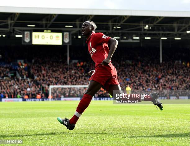 Sadio Mane of Liverpool celebrates after scoring the opening goal during the Premier League match between Fulham FC and Liverpool FC at Craven...