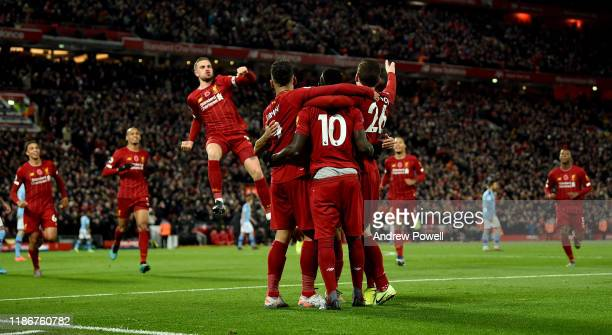 Sadio Mane of Liverpool celebrates after scoring the opening goal during the Premier League match between Liverpool FC and Manchester City at Anfield...