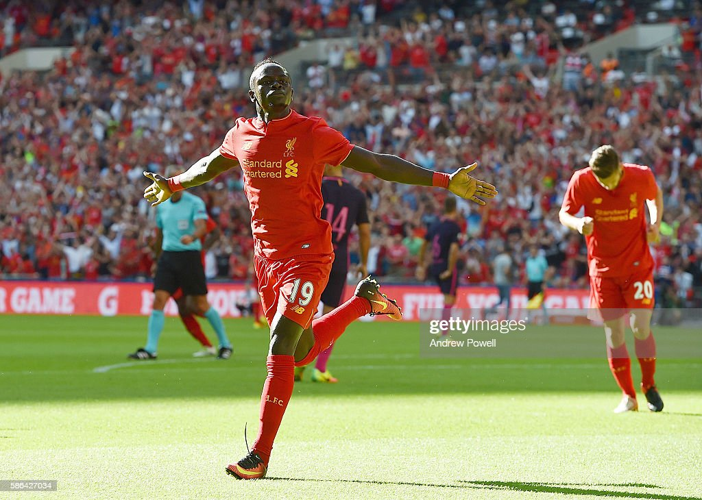 Sadio Mane of Liverpool celebrates after scoring the opening goal during the International Champions Cup match between Liverpool and Barcelona at Wembley Stadium on August 6, 2016 in London, England.