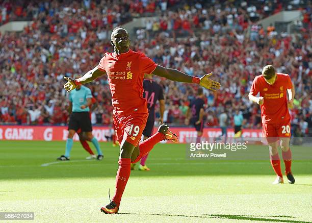 Sadio Mane of Liverpool celebrates after scoring the opening goal during the International Champions Cup match between Liverpool and Barcelona at...