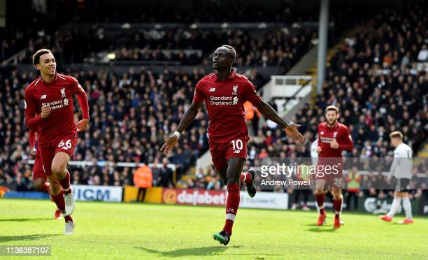 Sadio Mane of Liverpool celebrates after scoring the openiong goal during the Premier League match between Fulham FC and Liverpool FC at Craven...