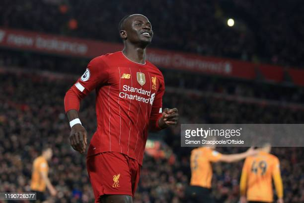 Sadio Mane of Liverpool celebrates after scoring their 1st goal during the Premier League match between Liverpool FC and Wolverhampton Wanderers at...
