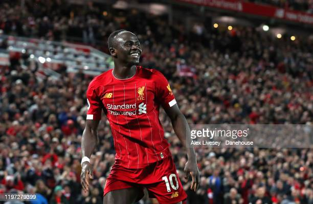Sadio Mane of Liverpool celebrates after scoring their second goal during the Premier League match between Liverpool FC and Sheffield United at...