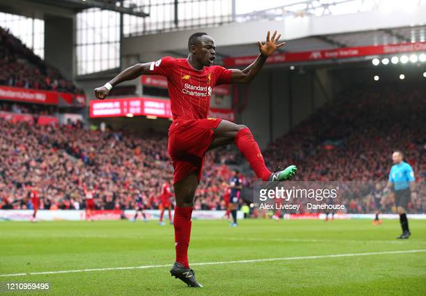 Sadio Mane of Liverpool celebrates after scoring their second goal during the Premier League match between Liverpool FC and AFC Bournemouth at...