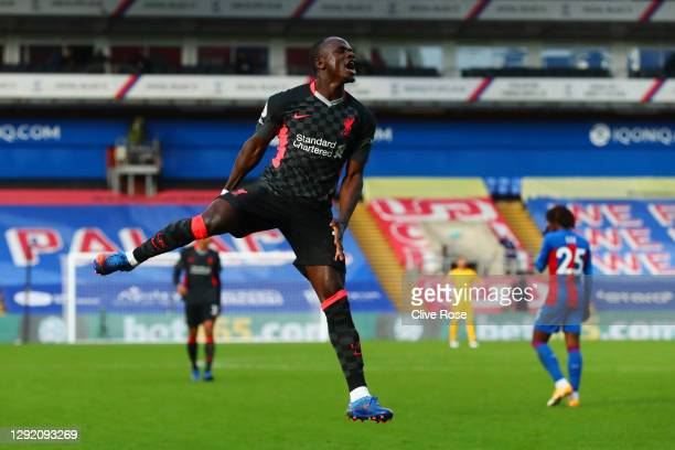 Sadio Mane of Liverpool celebrates after scoring their sides second goal during the Premier League match between Crystal Palace and Liverpool at...