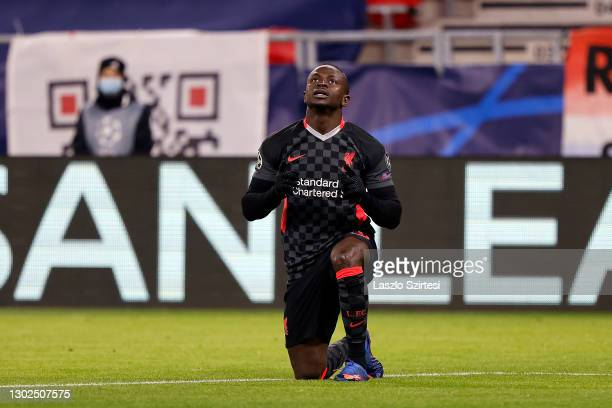 Sadio Mane of Liverpool celebrates after scoring their side's second goal during the UEFA Champions League Round of 16 match between RB Leipzig and...