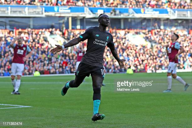 Sadio Mane of Liverpool celebrates after their team scores a goal during the Premier League match between Burnley FC and Liverpool FC at Turf Moor on...