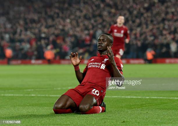 Sadio Mane of Liverpool celebrates as he scores his second goal and during the Premier League match between Liverpool FC and Watford FC at Anfield on...