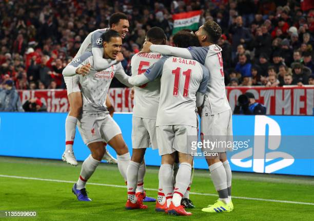 Sadio Mane of Liverpool celebrates as he scores his team's first goal with team mates during the UEFA Champions League Round of 16 Second Leg match...