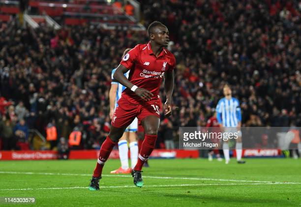 Sadio Mane of Liverpool celebrates as he scores his team's fourth goal during the Premier League match between Liverpool FC and Huddersfield Town at...
