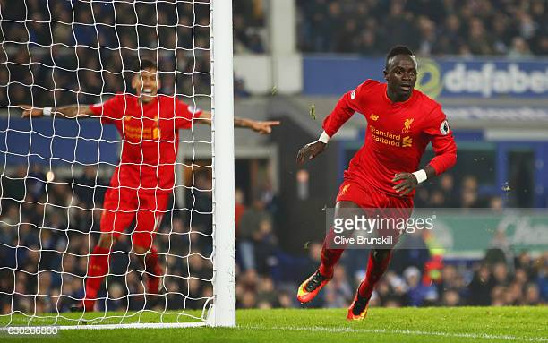 Sadio Mane of Liverpool celebrates as he scores their first goal during the Premier League match between Everton and Liverpool at Goodison Park on...
