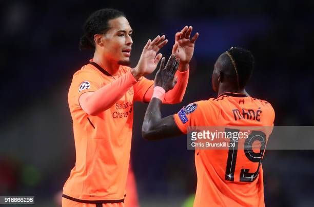 Sadio Mane of Liverpool celebrates scoring his side's fifth goal with Virgil Van Diyk during the UEFA Champions League Round of 16 First Leg match...