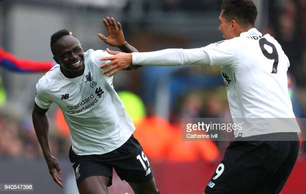 Sadio Mane of Liverpool celebrates scoring his sides first goal before his goal is then disallowed during the Premier League match between Crystal...