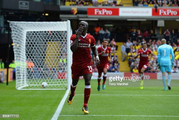 Sadio Mane of Liverpool celebrates scoring his sides first goal during the Premier League match between Watford and Liverpool at Vicarage Road on...