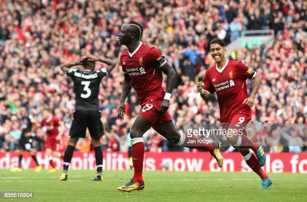 Sadio Mane of Liverpool celebrates scoring his sides first goal during the Premier League match between Liverpool and Crystal Palace at Anfield on...