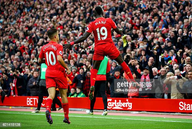 Sadio Mane of Liverpool celebrates scoring his sides first goal with Philippe Coutinho of Liverpool during the Premier League match between Liverpool...