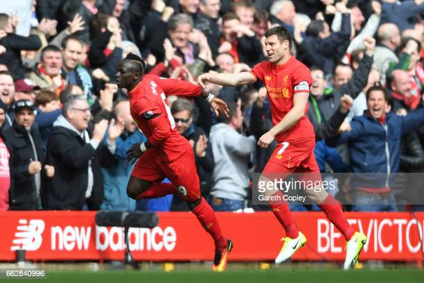 Sadio Mane of Liverpool celebrates scoring his sides first goal with James Milner of Liverpool during the Premier League match between Liverpool and...