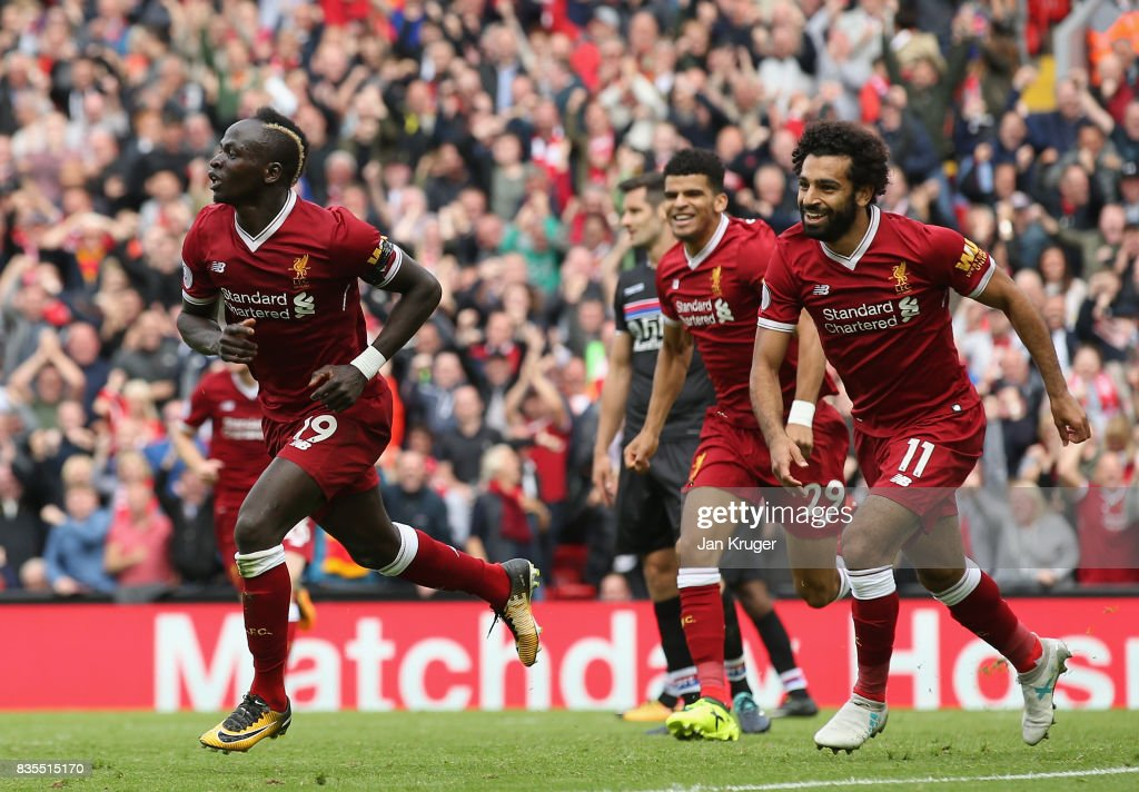 Sadio Mane of Liverpool celebrates scoring his sides first goal with his Liverpool team mates during the Premier League match between Liverpool and Crystal Palace at Anfield on August 19, 2017 in Liverpool, England.