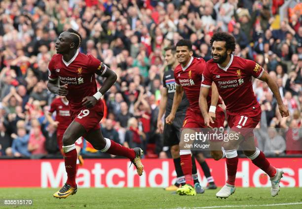Sadio Mane of Liverpool celebrates scoring his sides first goal with his Liverpool team mates during the Premier League match between Liverpool and...