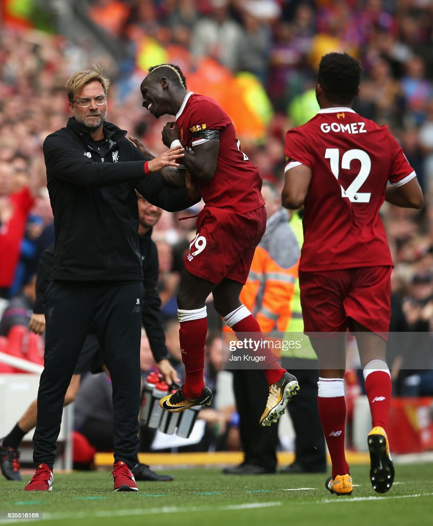 Sadio Mane of Liverpool celebrates scoring his sides first goal with Jurgen Klopp, Manager of Liverpool during the Premier League match between Liverpool and Crystal Palace at Anfield on August 19, 2017 in Liverpool, England.