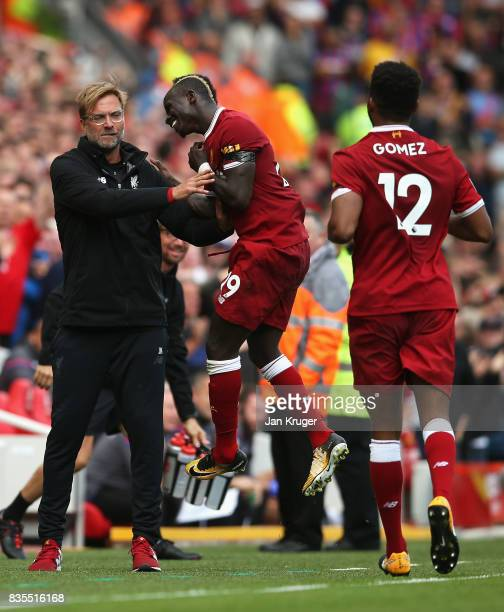 Sadio Mane of Liverpool celebrates scoring his sides first goal with Jurgen Klopp Manager of Liverpool during the Premier League match between...