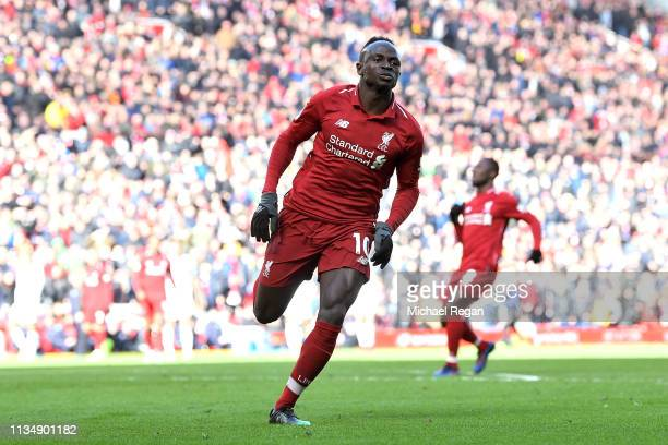 Sadio Mane of Liverpool celebrates scoring his sides fourth goal during the Premier League match between Liverpool FC and Burnley FC at Anfield on...