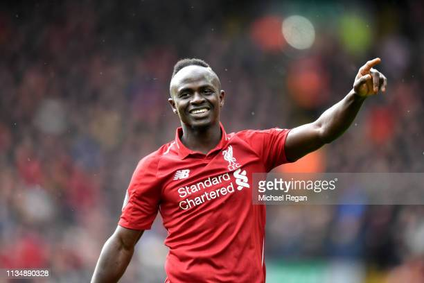 Sadio Mane of Liverpool celebrates scoring his sides second goal during the Premier League match between Liverpool FC and Burnley FC at Anfield on...
