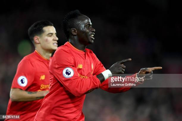 Sadio Mane of Liverpool celebrates scoring his sides second goal during the Premier League match between Liverpool and Arsenal at Anfield on March 4...