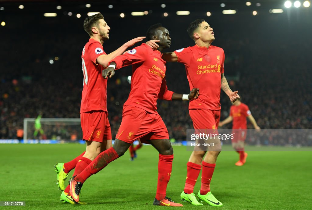 Sadio Mane (C) of Liverpool celebrates scoring his side's second goal with his team mate Philippe Coutinho (R) and Adam Lallana (L) during the Premier League match between Liverpool and Tottenham Hotspur at Anfield on February 11, 2017 in Liverpool, England.