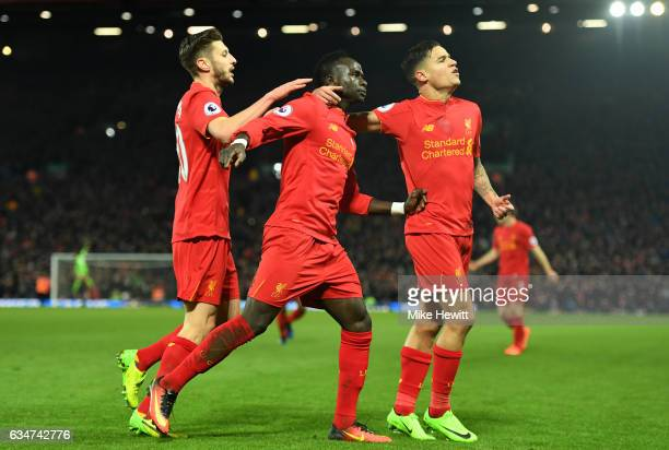 Sadio Mane of Liverpool celebrates scoring his side's second goal with his team mate Philippe Coutinho and Adam Lallana during the Premier League...