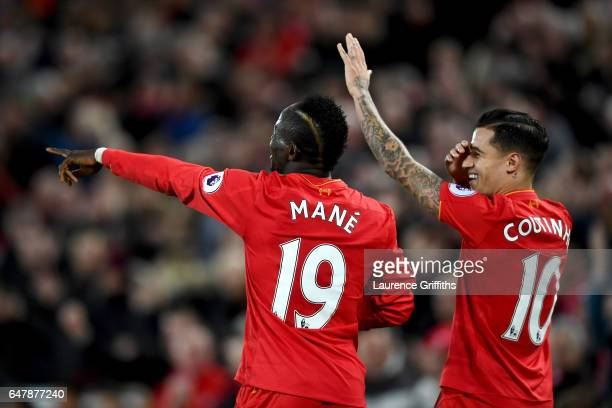 Sadio Mane of Liverpool celebrates scoring his sides second goal with Philippe Coutinho of Liverpool during the Premier League match between...