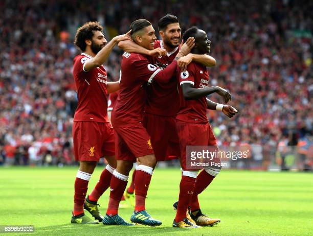 Sadio Mane of Liverpool celebrates scoring his sides second goal with his Liverpool team mates during the Premier League match between Liverpool and...