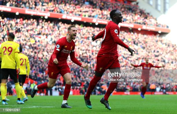 Sadio Mane of Liverpool celebrates scoring his teams second goal which is later ruled out by VAR during the Premier League match between Liverpool FC...
