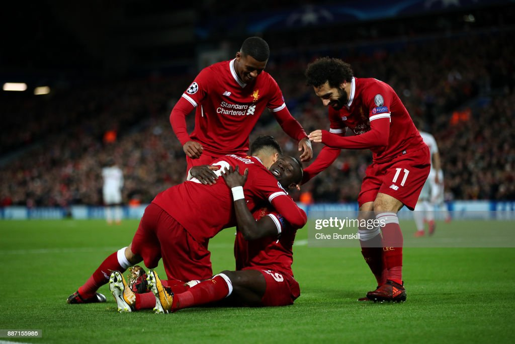 Sadio Mane of Liverpool celebrates scoring the 4th Liverpool goal with team mates during the UEFA Champions League group E match between Liverpool FC and Spartak Moskva at Anfield on December 6, 2017 in Liverpool, United Kingdom.