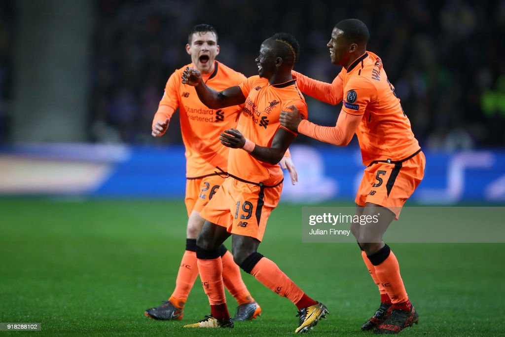Sadio Mane of Liverpool celebrates scoring the first goal with Georginio Wijnaldum and Andy Robertson during the UEFA Champions League Round of 16 First Leg match between FC Porto and Liverpool at Estadio do Dragao on February 14, 2018 in Porto, Portugal.