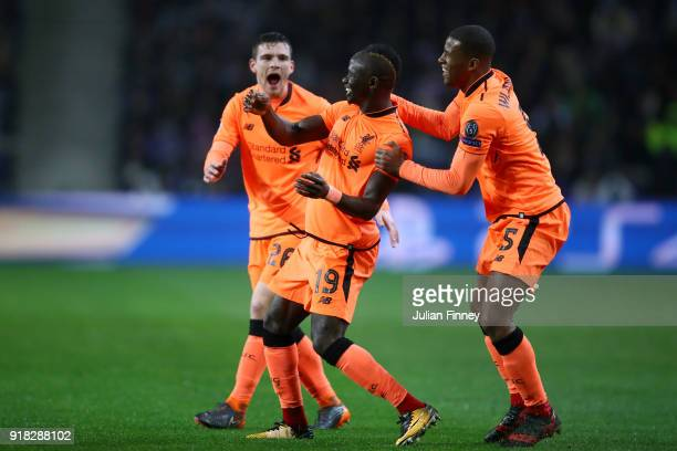Sadio Mane of Liverpool celebrates scoring the first goal with Georginio Wijnaldum and Andy Robertson during the UEFA Champions League Round of 16...