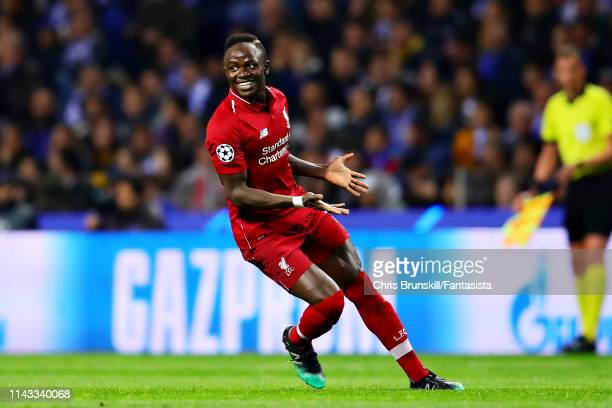 Sadio Mane of Liverpool celebrates scoring the opening goal during the UEFA Champions League Quarter Final second leg match between Porto and...
