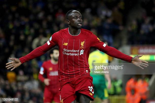 Sadio Mane of Liverpool celebrates scoring the opening goal during the Premier League match between Norwich City and Liverpool FC at Carrow Road on...